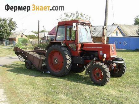 Трактор с картофелекопателем
