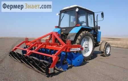 Трактор МТЗ с дискатором