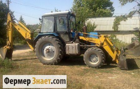 Трактор с навесным оборудованием